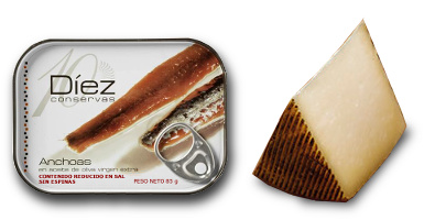 Can of Cantabrian Anchovies and a wedge of Manchego Cheese